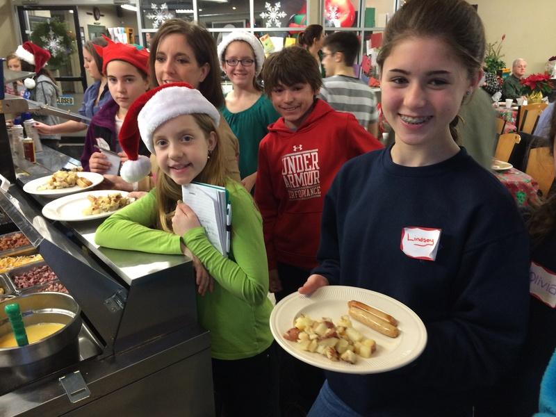 Students serving breakfast